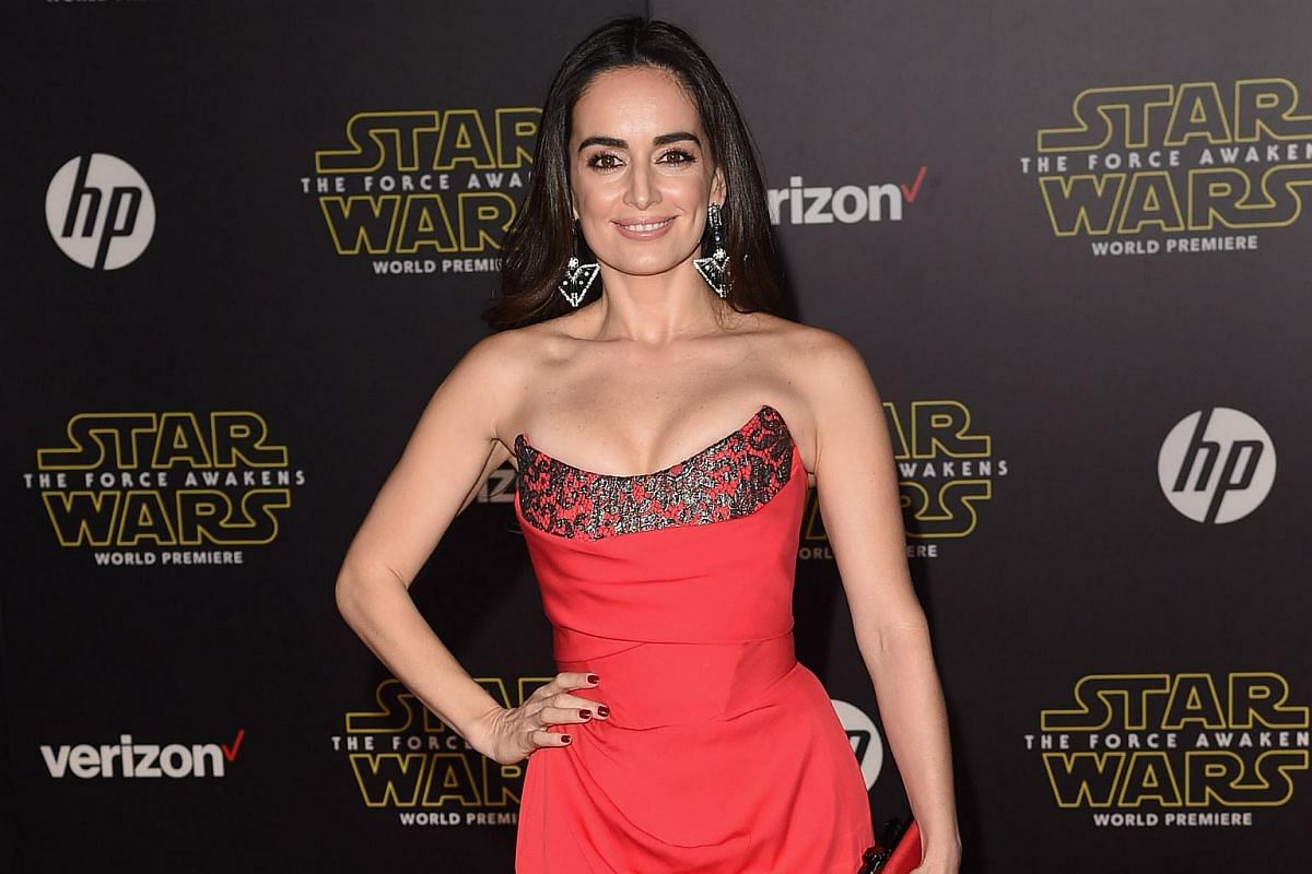 Actress Ana de la Reguera arriving at the premiere of Star Wars: The Force Awakens.