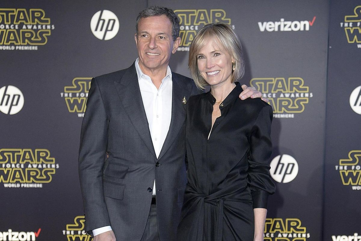 Disney CEO Robert Iger and guest arriving at the premiere of Star Wars: The Force Awakens.