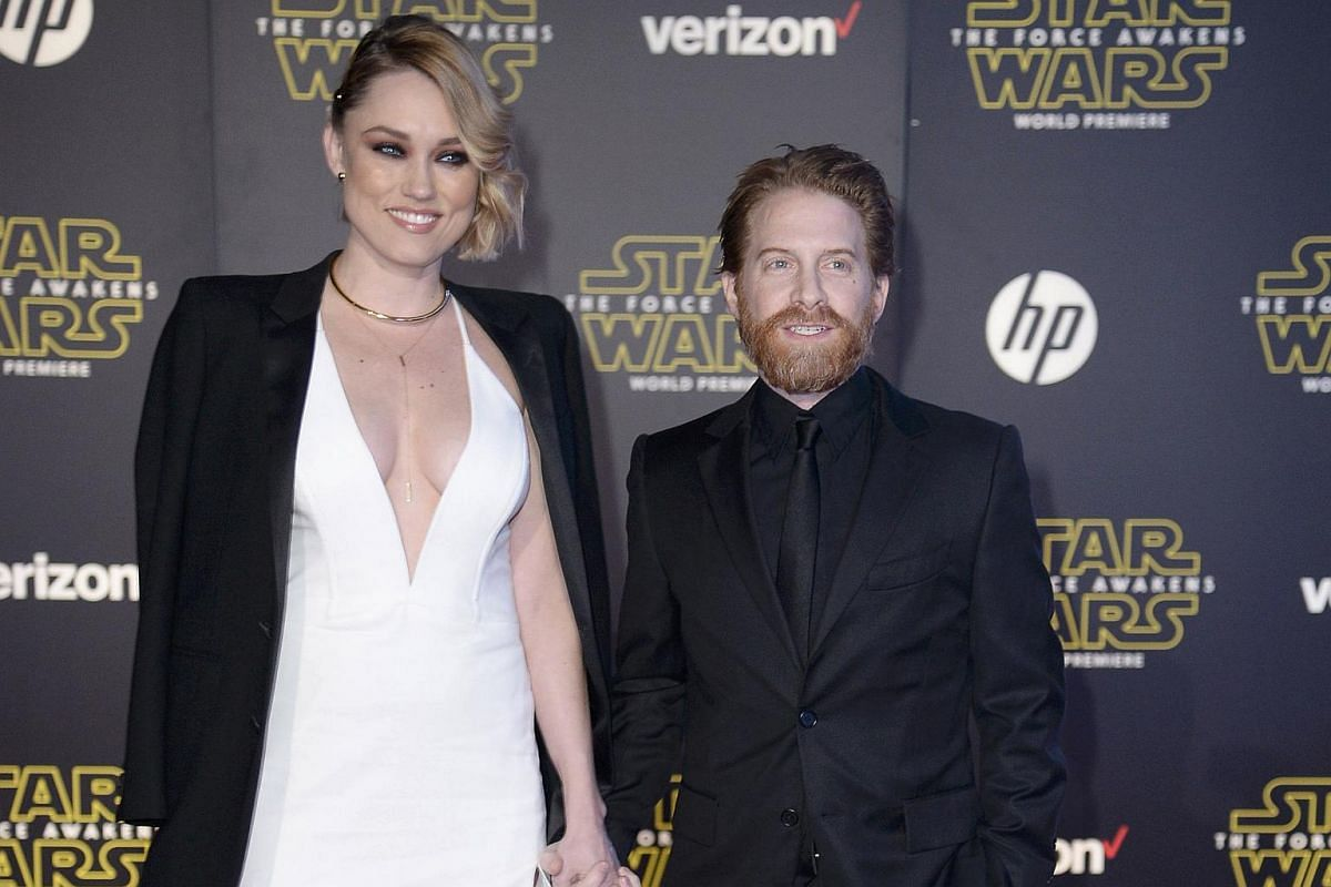 Actor Seth Green (right) and wife, actress Clare Grant, arriving at the premiere of Star Wars: The Force Awakens.