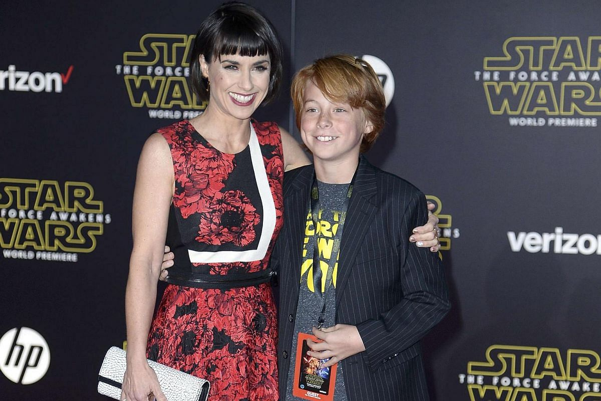 Actress Constance Zimmer and her nephew arriving at the premiere of Star Wars: The Force Awakens.