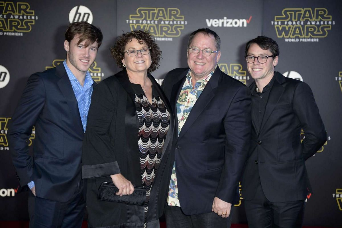 Animator John Lasseter (centre, right) and family arriving at the premiere of Star Wars: The Force Awakens.