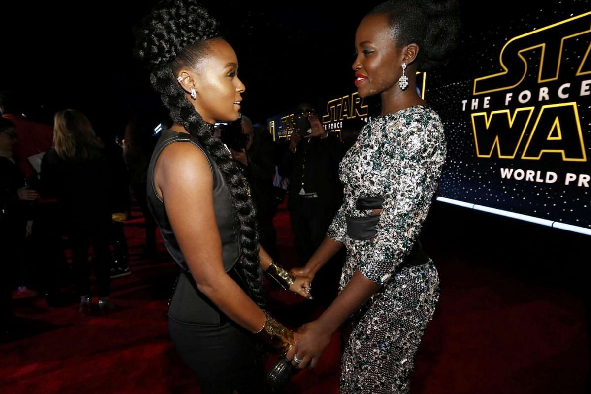 Actress Lupita Nyong'o (right) and singer Janelle Monae chatting as they arrive at the premiere of Star Wars: The Force Awakens.