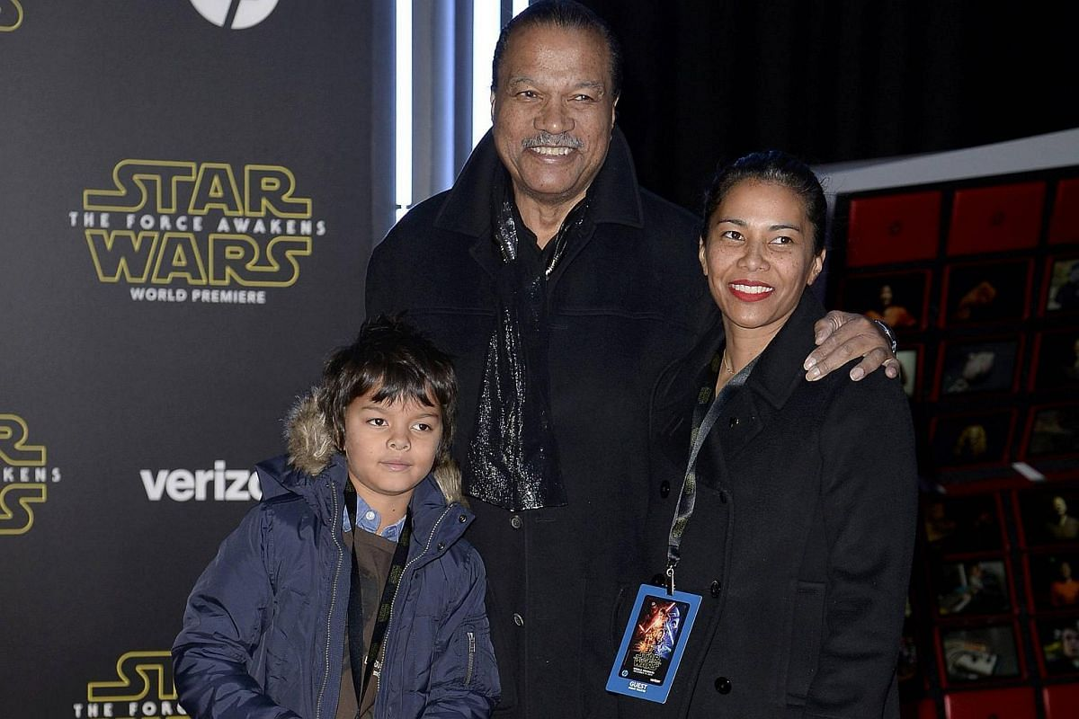Actor Billy Dee Williams and family arriving at the premiere of Star Wars: The Force Awakens.