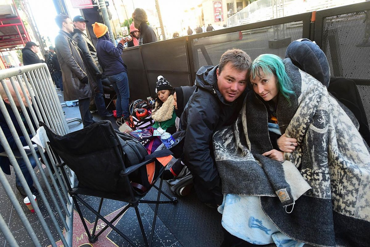 Australian couple Caroline Ritter and Andrew Porters holding their spot in a line of hardcore Star Wars fans who have been camping out for the premiere of the latest Star Wars film.