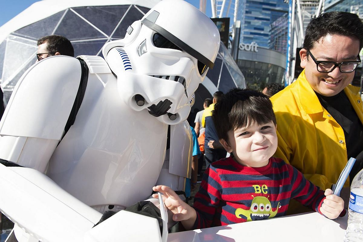 Fans at The Star Wars Galactic Experience at LA Live in Los Angeles, California, on Dec 12, 2015.