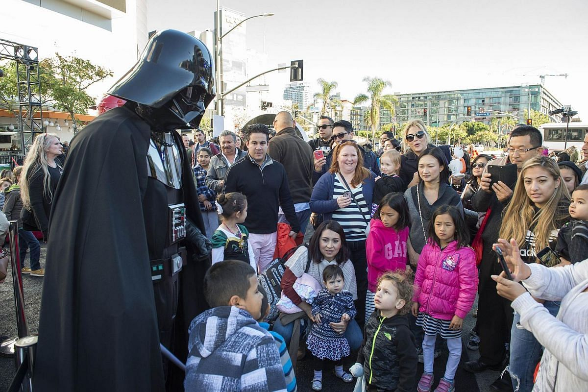 Dark Vader poses with fans at The Star Wars Galactic Experience at LA Live in Los Angeles, California, on Dec 12, 2015.