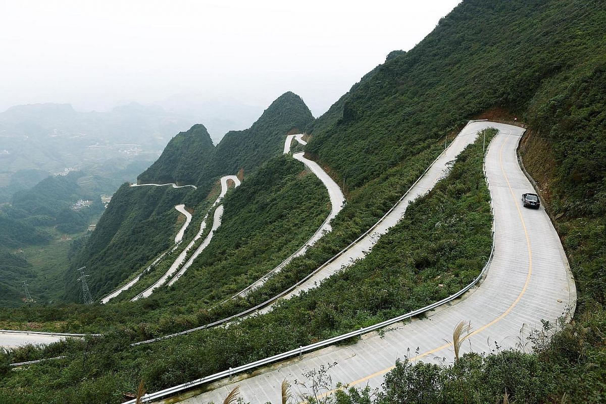 Chongqing's mountainous terrain makes building roads difficult and expensive. This 5.7km stretch of road (top) from the ancient town of Hongan to the Chuanhegai grasslands is said to pass through an elevation of 550m, and has an estimated 45 turns. T
