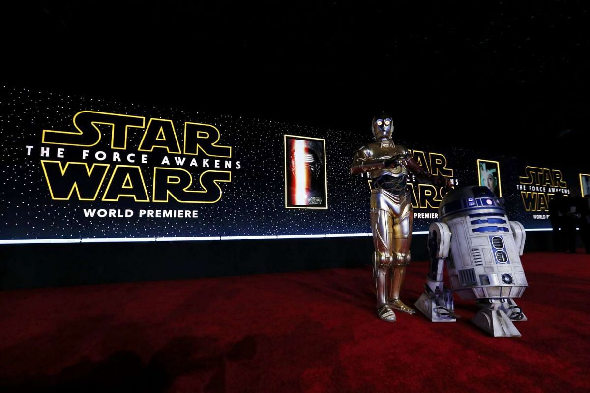 C-3PO (left) and R2-D2 arriving at the world premiere of Star Wars: The Force Awakens in Hollywood, California, on Dec 14, 2015.