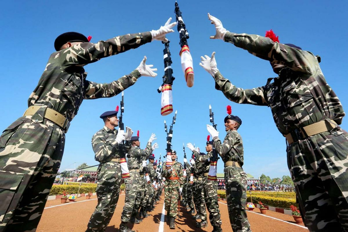 India's Central Armed Police Forces, Sashastra Seema Bal (SSB) personnel take part in a passing out parade at their training headquarters near Bhopal, India, 15 December 2015. PHOTO: EPA