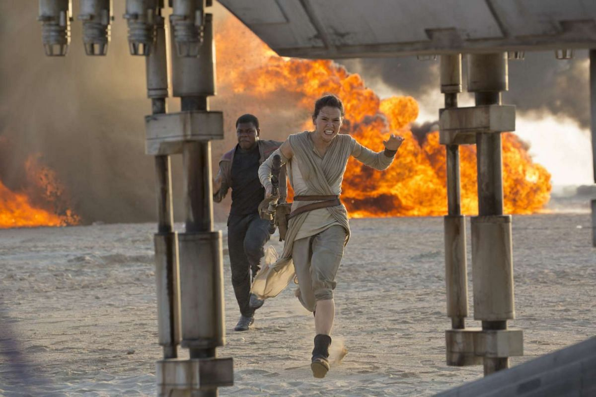 Daisy Ridley (right, with John Boyega in a scene from the movie).