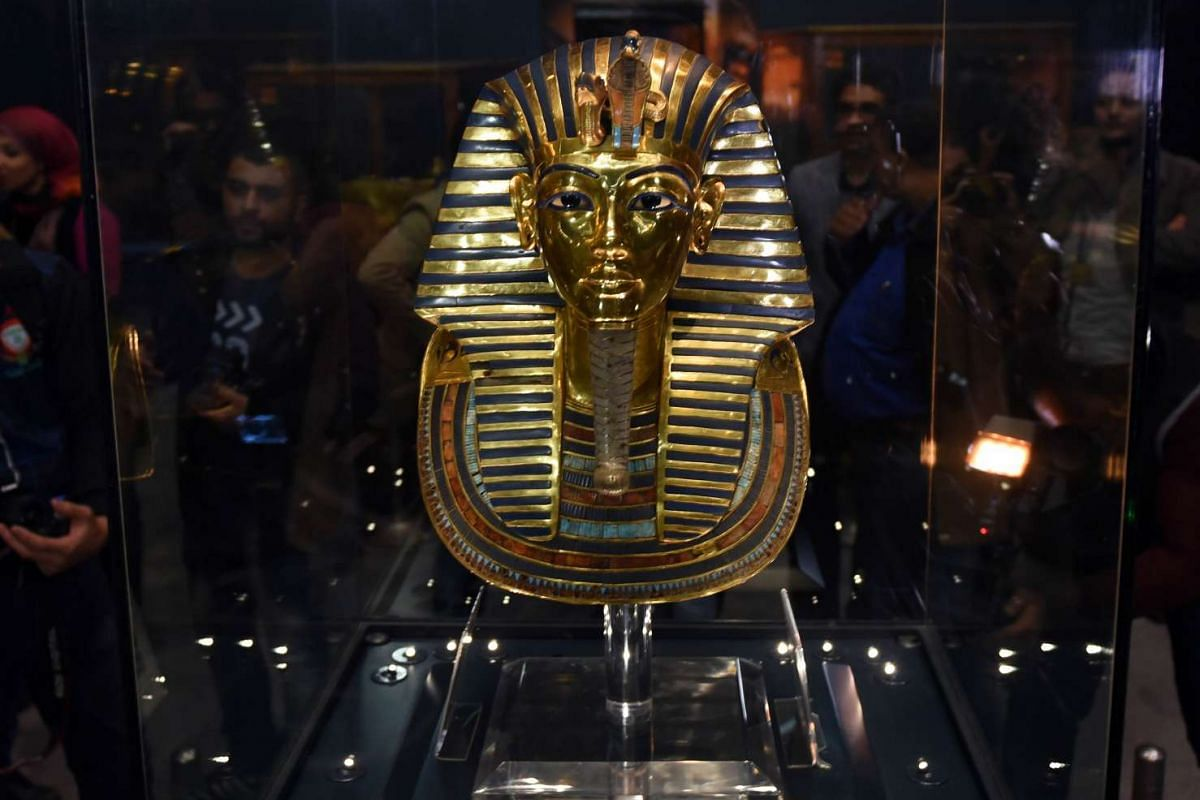 The golden mask of legendary Egyptian boy king Tutankhamun is displayed at the Egyptian Museum in Cairo after its restoration, on December 16, 2015. PHOTO: AFP