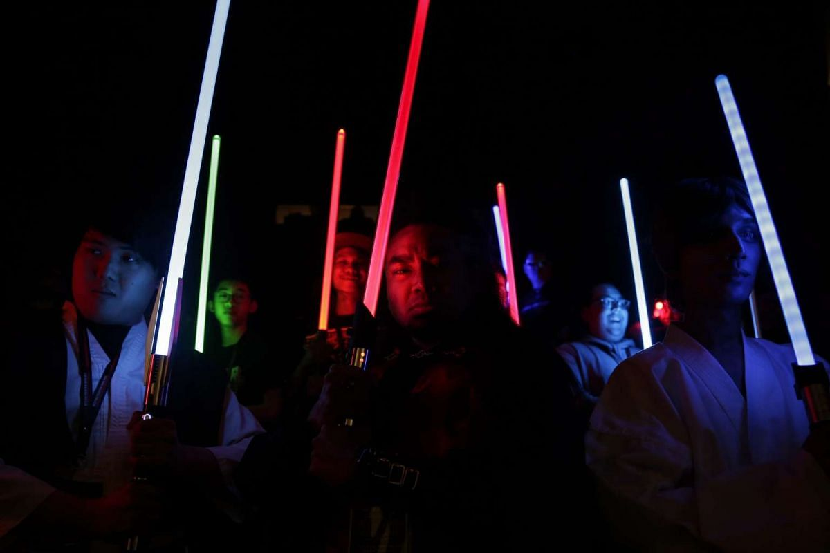 Members of a Star Wars fan club pose for pictures before the film premiere of 'Star Wars: The Force Awakens' at Subang Jaya, Selangor, Malaysia, 16 December 2015. PHOTO: EPA