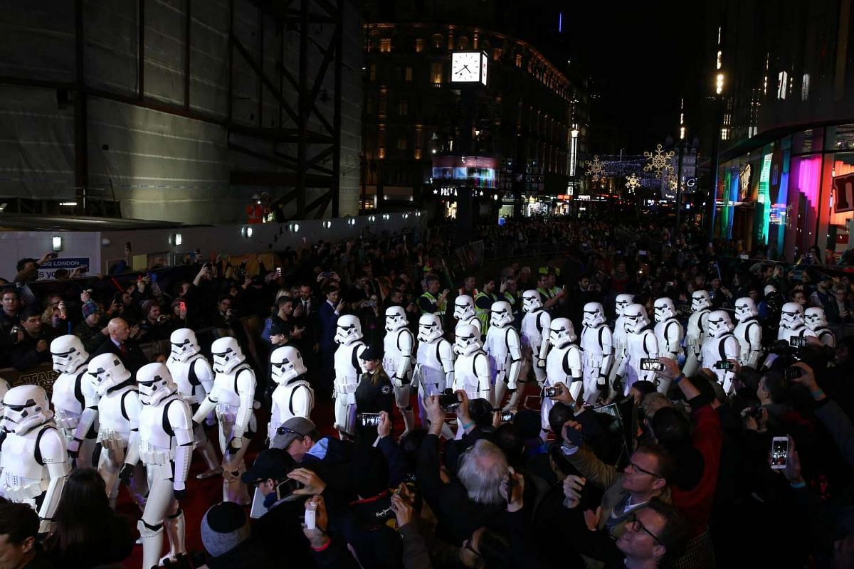 Fans and Stormtroopers arrive for the European premiere of Star Wars: The Force Awakens at Leicester Square in London.