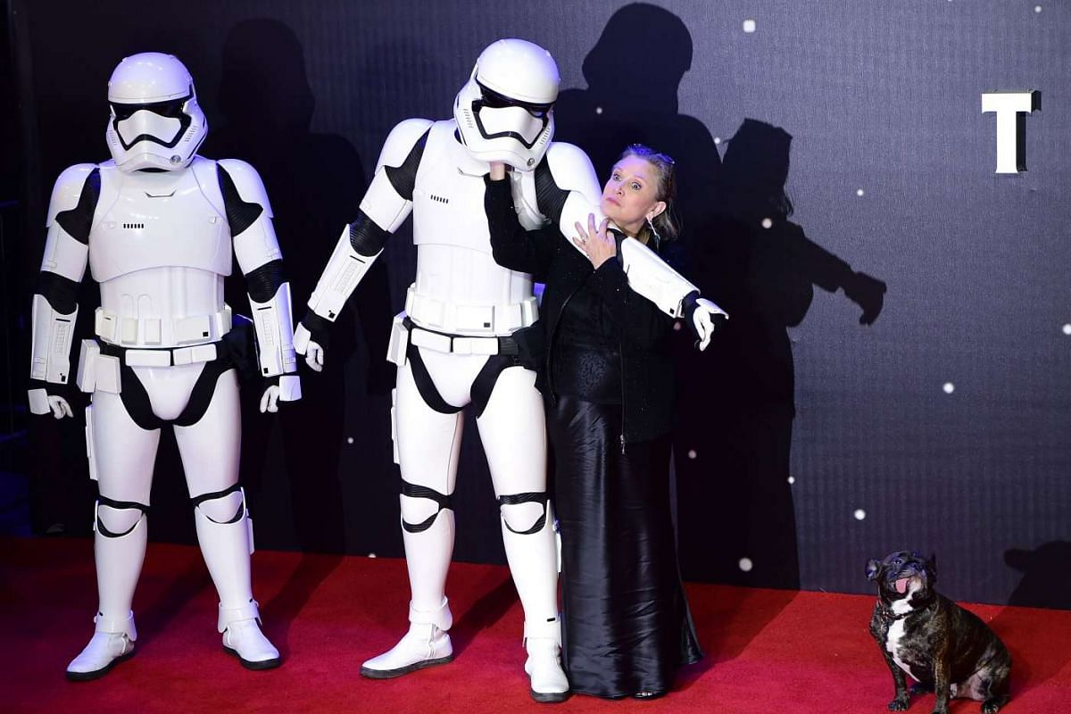 Carrie Fisher (right) poses with a Stormtrooper at the opening of the European premiere of Star Wars: The Force Awakens at Leicester Square in London.