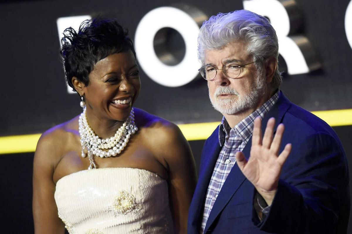 George Lucas and his wife Mellody Hobson arrive at the European premiere of Star Wars: The Force Awakens at Leicester Square in London.