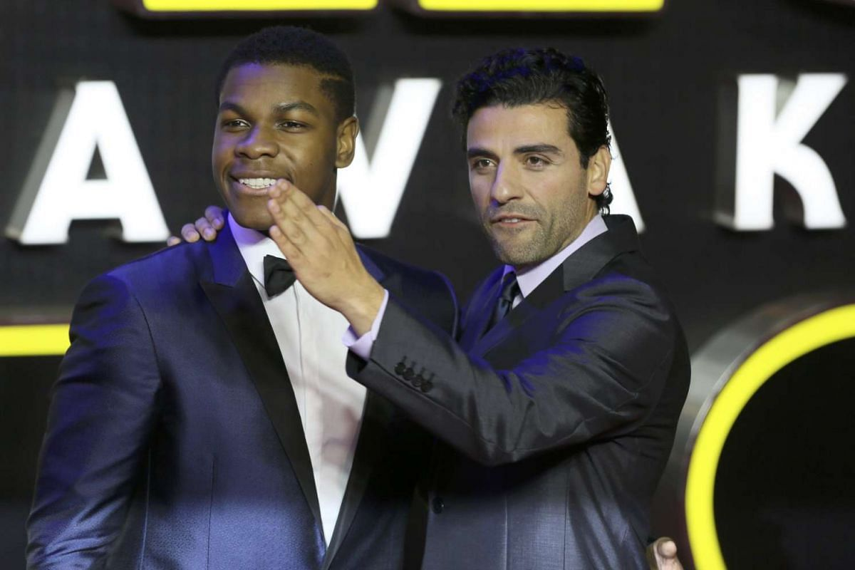 John Boyega (left) and Oscar Isaac arrive at the European Premiere of Star Wars: The Force Awakens at Leicester Square in London.