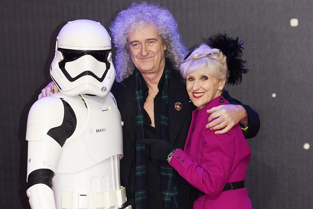 British musician Brian May and wife Anita Dobson posing with a Stormtrooper before the European premiere of Star Wars: The Force Awakens at Leicester Square in London.