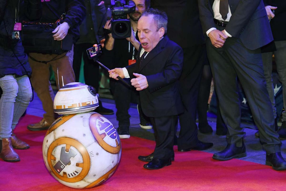 British actor Warwick Ashley Davis with the droid character BB-8 at the European premiere of Star Wars: The Force Awakens at Leicester Square in London.