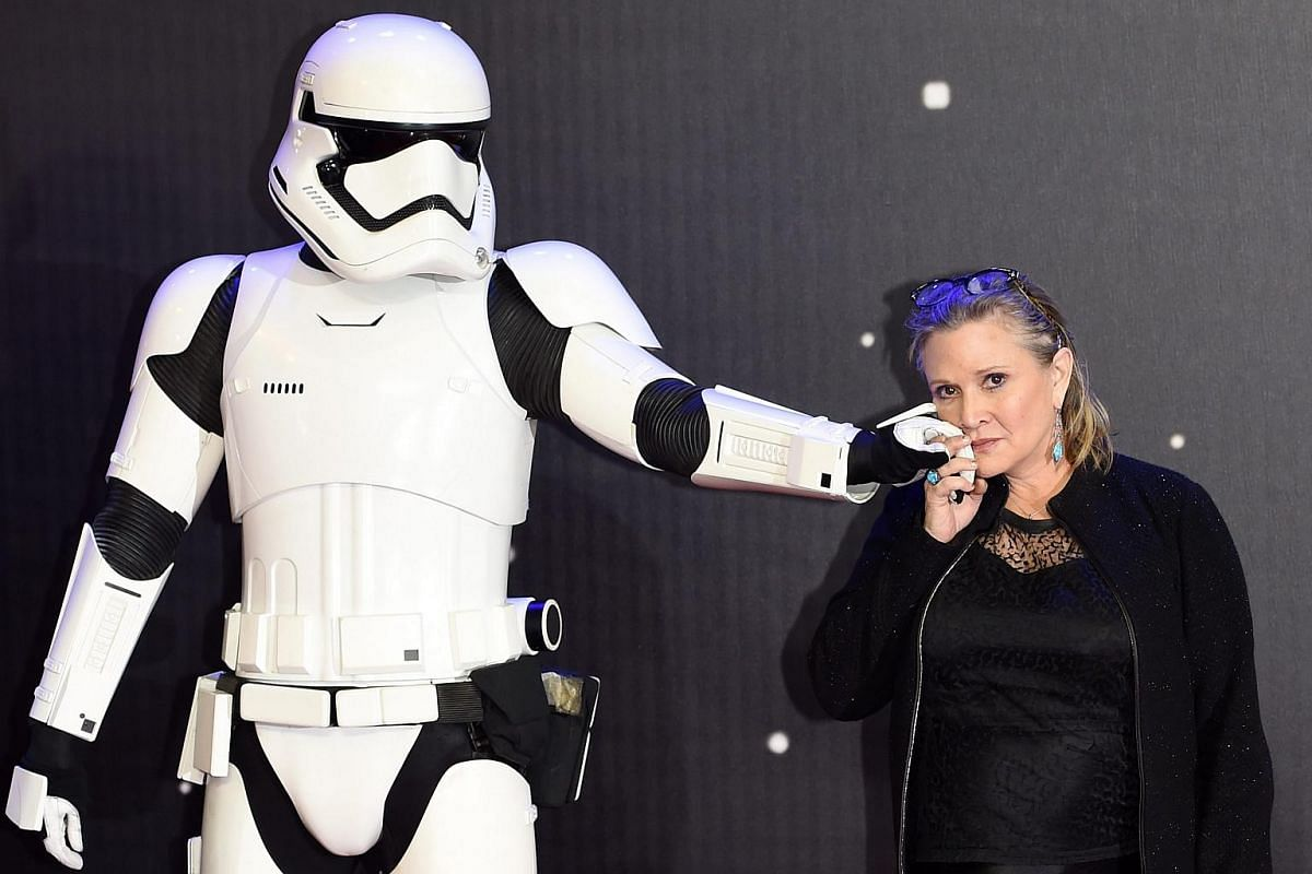 Carrie Fisher (right) poses next to a Stormtrooper as she arrives at the European premiere of Star Wars: The Force Awakens at Leicester Square in London.