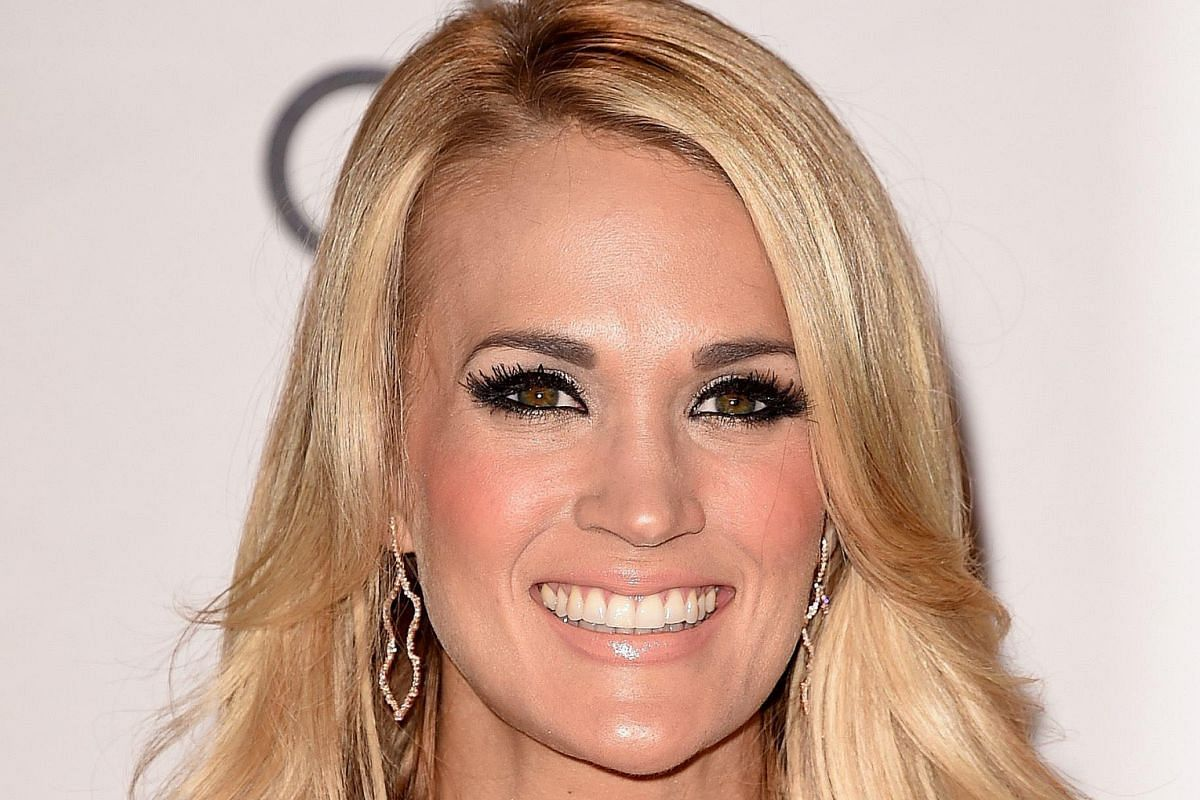 Singer Rihanna loads on the mascara for a glamorous look. Actress Camilla Belle (left) goes for a symmetrical smoky eye look. Singer Taylor Swift's (above left) glittery eyeshadow is striking while recording artist Carrie Underwood (above right) uses