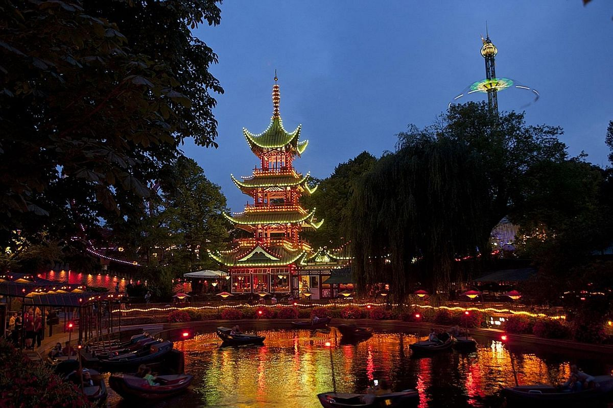 The gardens, with its pagodas and ponds, opened in 1843 and is the second oldest in the world. Left: Nimb Hotel, the only hotel located within the grounds of Tivoli Gardens. Right: For less than $45, you get entry to the park and admission to all rid