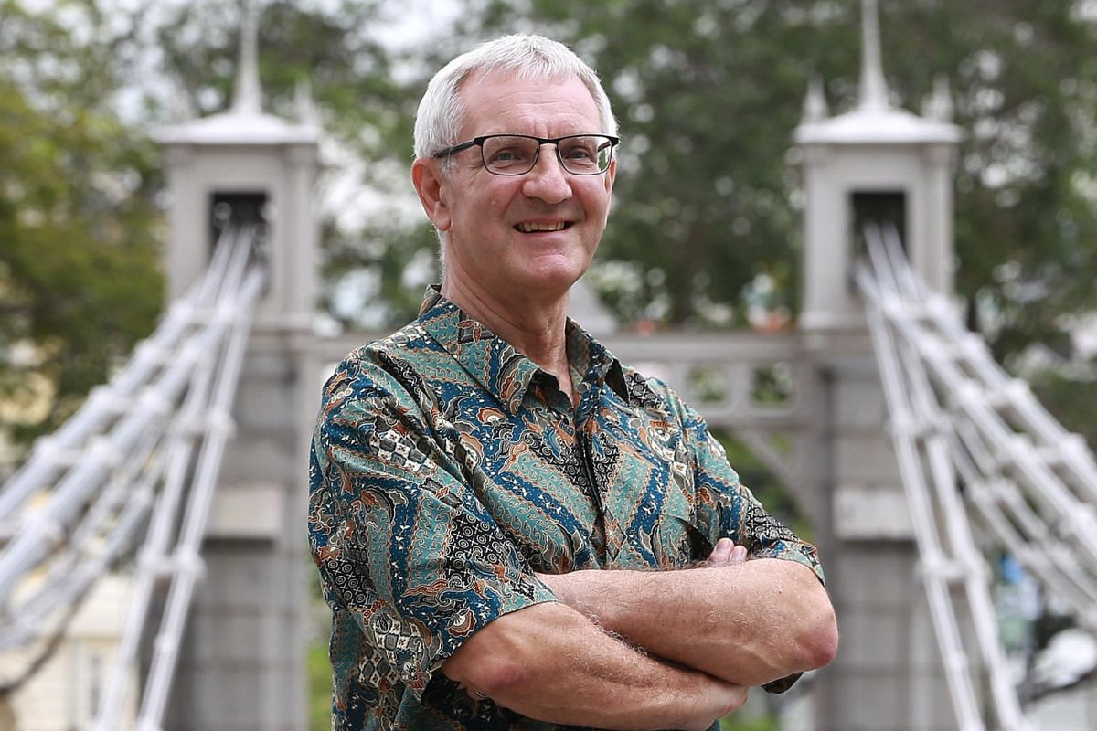 Mr Graham Berry at Cavenagh Bridge, which was originally named Edinburgh Bridge. Most of the bridges and ironwork in Singapore were built by the Scots.