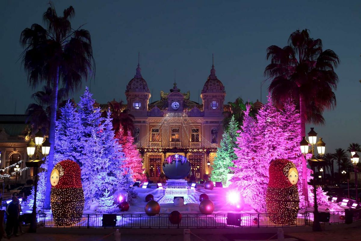 Christmas trees frame the Monte Carlo Casino as part of the holiday season decoration in Monaco on Dec 10, 2015.