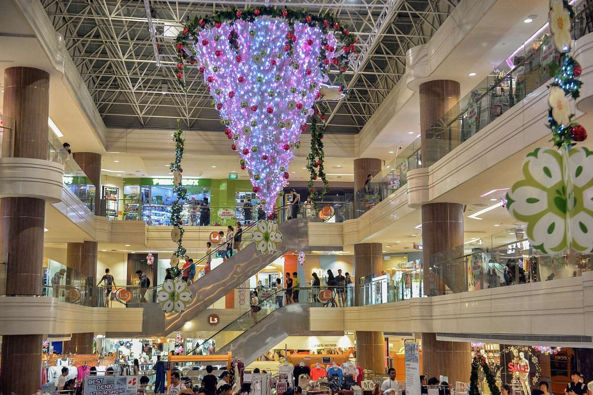 Shoppers' eyes are drawn upwards to a sparkling upside-down Christmas tree hanging overhead at Junction 8.