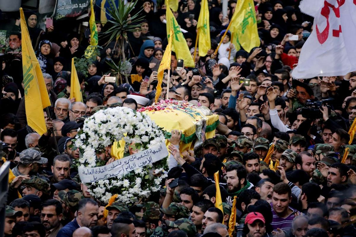 Hizbollah members carry the coffin of Samir al-Qantar, a Lebanese Hizbollah militant who was assassinated on Dec 21, 2015.