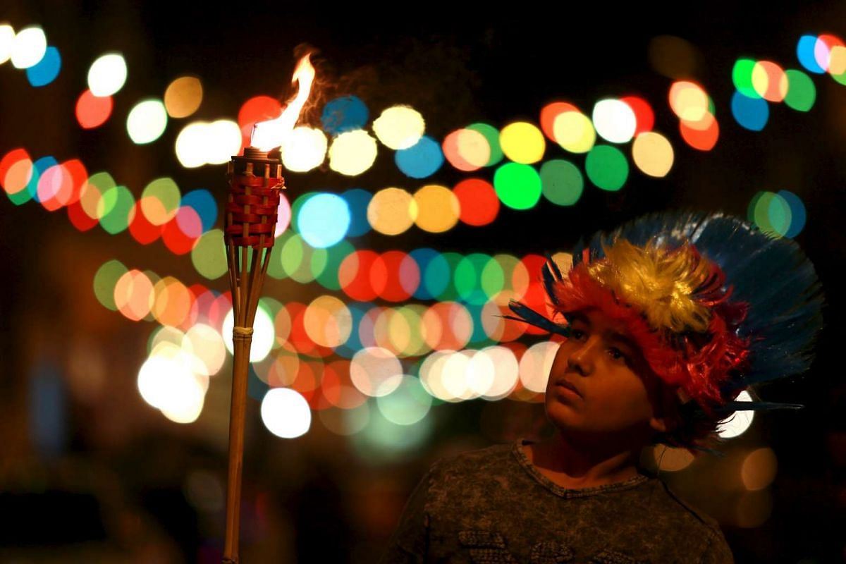 A boy carries a torch during a procession to celebrate the birth of Prophet Mohammad in Benghazi, Libya on Dec 22, 2015.