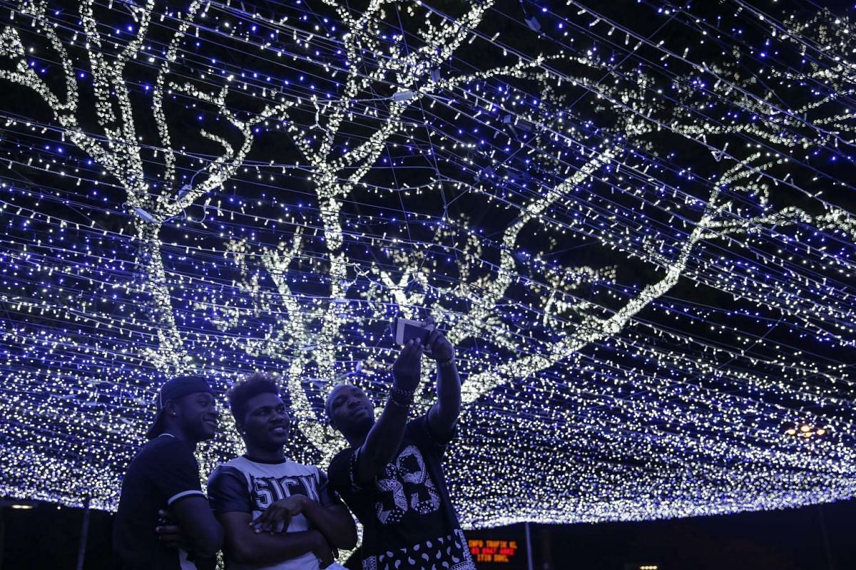 Men take a selfie with Christmas decorations in Kuala Lumpur, Malaysia on Dec 22, 2015.