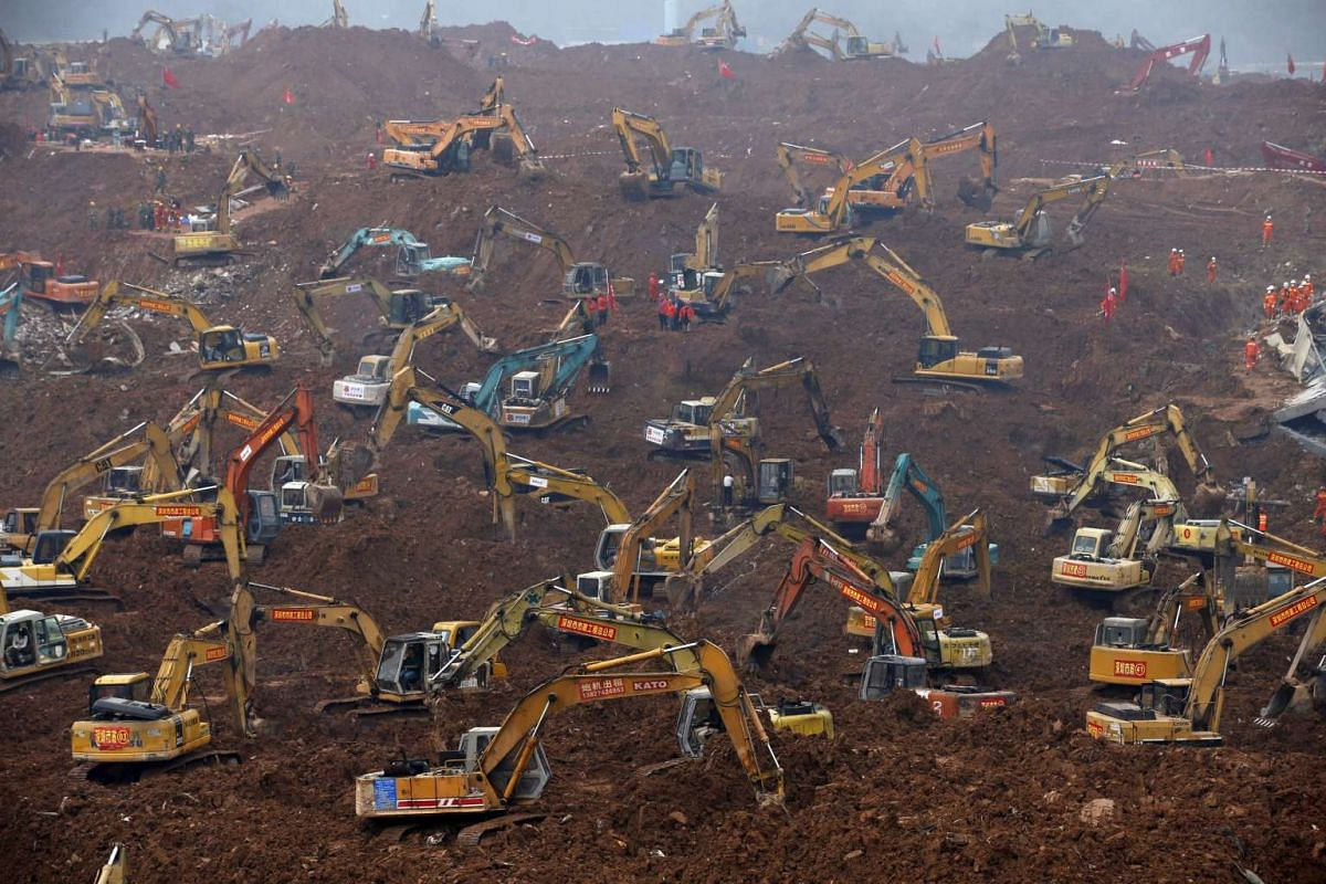 Excavators are seen during rescue operations at an industrial estate hit by a landslide in Shenzhen, Guangdong province on Dec 23, 2015.