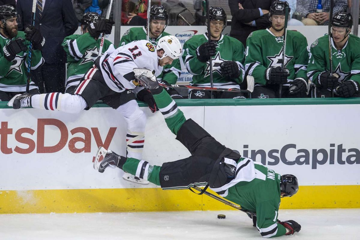 Chicago Blackhawks centre Andrew Desjardins (11) checks Dallas Stars left wing Jamie Benn (14) during the first period at the American Airlines Centre.