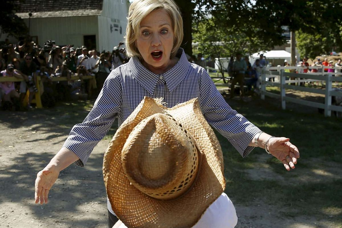 US Democratic presidential candidate Hillary Clinton greeting Louie Dixon as she campaigns at the Iowa State Fair in Des Moines, Iowa, United States, on Aug 15, 2015.