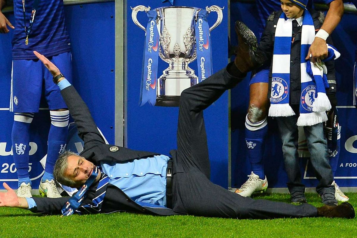 Chelsea manager Jose Mourinho celebrating as his players celebrate with the trophy after Chelsea won the League Cup final against Tottenham Hotspur at Wembley Stadium in London on March 1, 2015.
