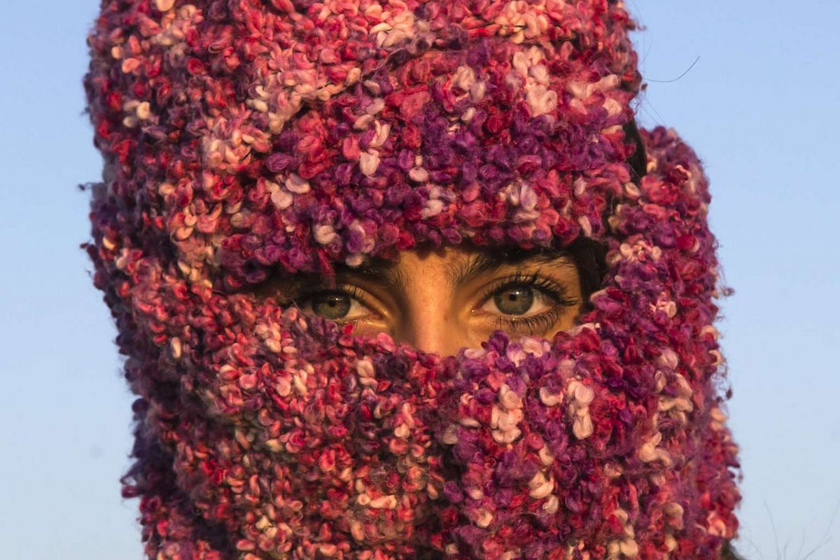 A woman from Syria looking on as she waits to cross the Croatian border near the village of Berkasovo, Serbia, on Oct 21, 2015.