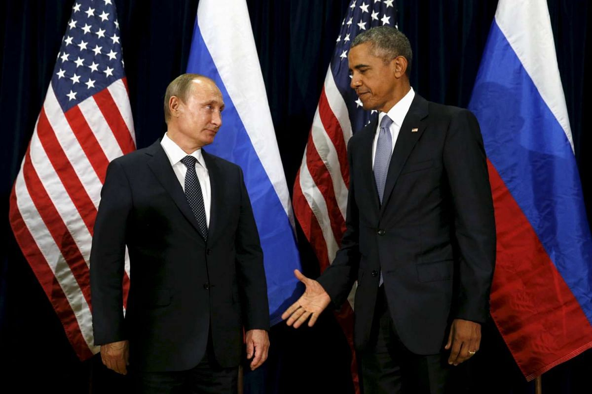 US President Barack Obama extending his hand to Russian President Vladimir Putin during their meeting at the United Nations General Assembly in New York on Sept 28, 2015.