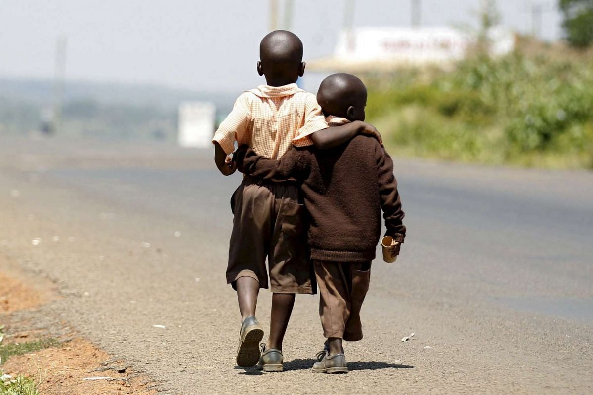 Boys walking home for lunch from school in the village of Kogelo, west of Kenya's capital Nairobi,  on July 16, 2015.
