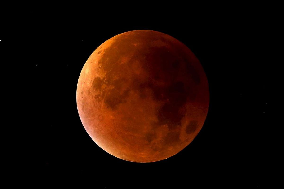 A lunar eclipse coincides with a supermoon in Newcastle-under-Lyme, Staffordshire, England, on Sept 28, 2015.