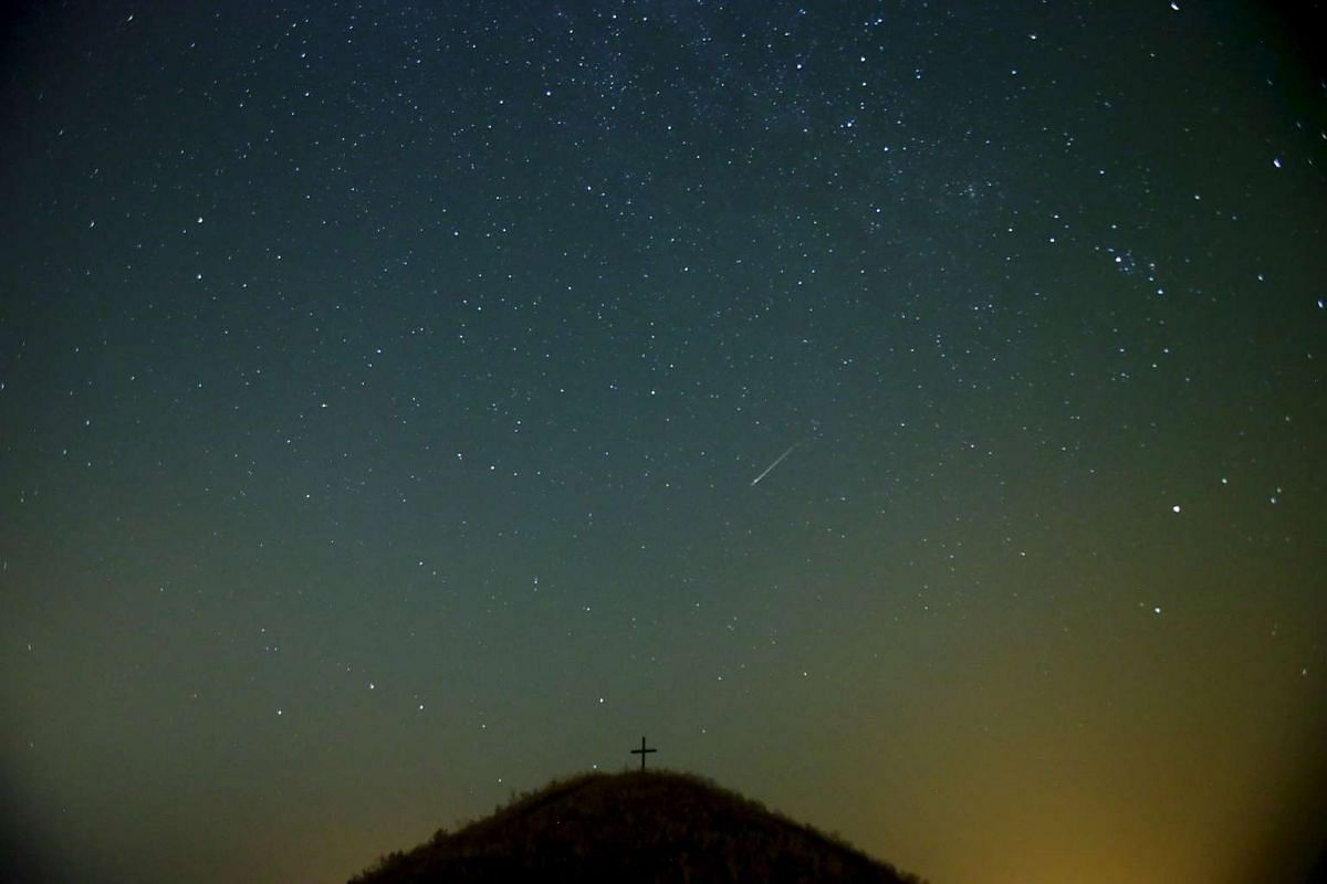 A meteor streaking across the sky over Leeberg hill during the Perseid meteor shower near Grossmugl in the early morning of Aug 13, 2015.
