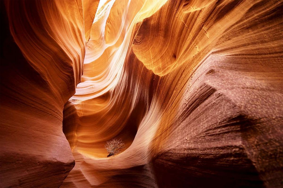 Sandstone sculpted by water and wind erosion is seen in a slot canyon, one of hundreds that surround Lake Powell near Page, Arizona, United States on May 26, 2015.