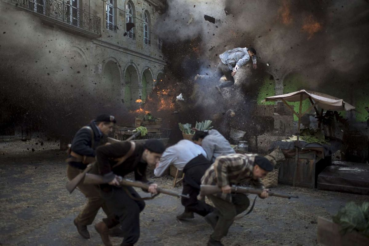 A stuntman flying through the air following an explosion during the filming of the Koldo Serra-directed feature film Gernika in the Basque town of Guernica, northern Spain on June 17, 2015.