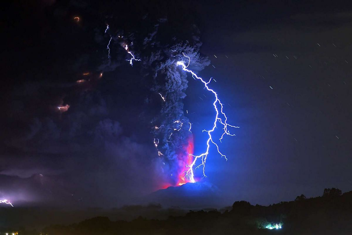 The view from Frutillar, southern Chile, showing volcanic lightning and lava spewed from the Calbuco volcano on April 23, 2015.