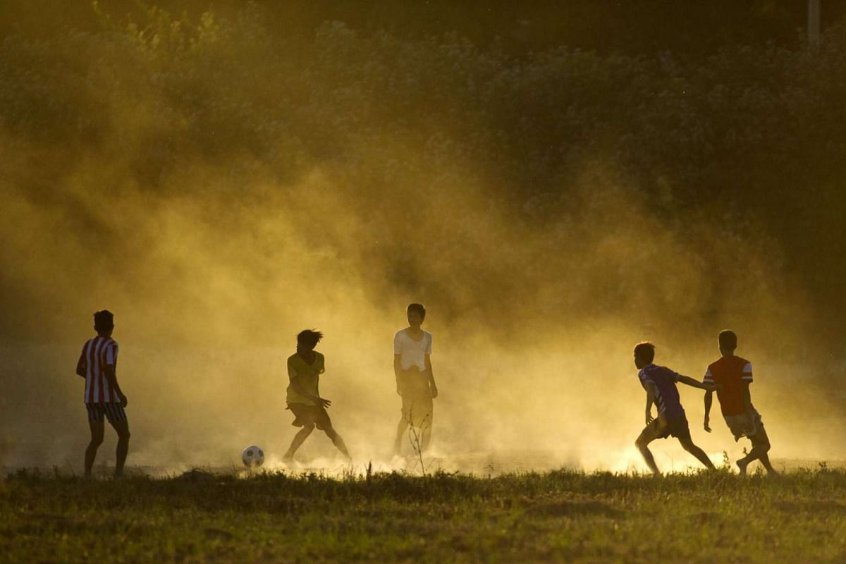 Myanmar youths playing football on the outskirts of Bago Division, around 112.7km north of Yangon on Dec 23, 2015.