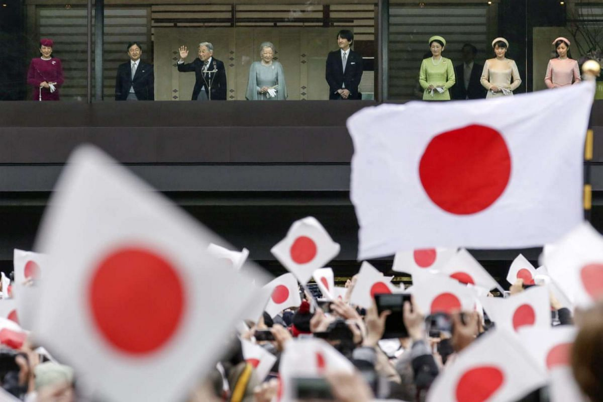 Japan's Emperor Akihito (third from left) waving to the crowd as he stands next to Empress Michiko and the Imperial family, from the balcony of the Imperial Palace in Tokyo, Japan on Dec 23, 2015.