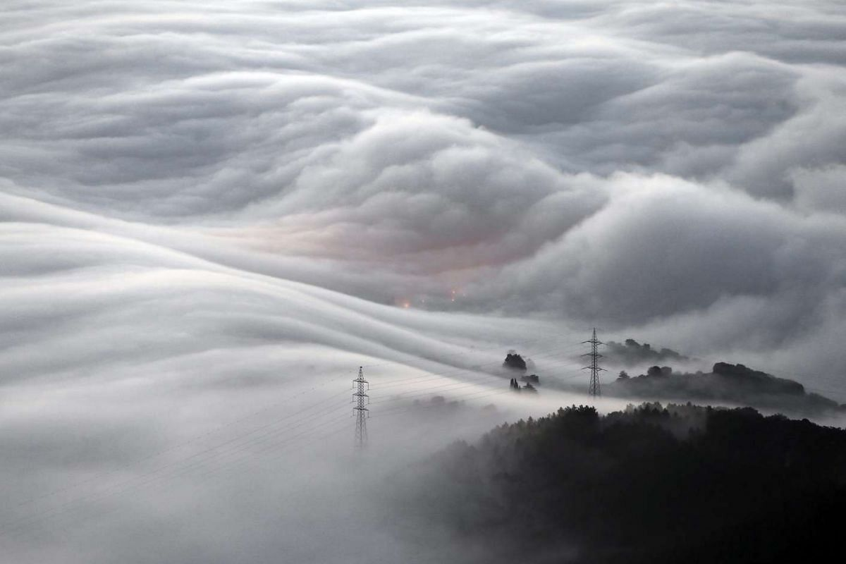 A mountainous landscape in Pamplona covered in a thick blanket of smog on Dec 23, 2015, in Pamplona, northern Spain.