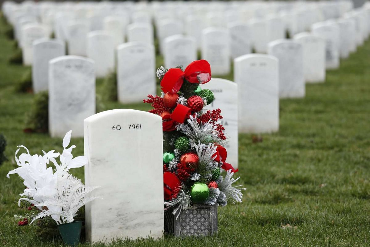 A Christmas arrangement sitting among graves in Arlington National Cemetery's Section 60 in Virginia on Dec 22, 2015.