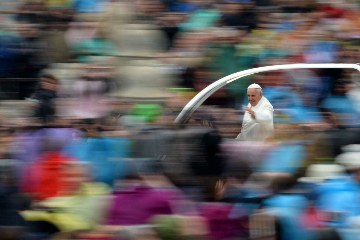 Pope Francis greeting the crowd from the popemobile after the Easter Mass on April 5, 2015 in Vatican.