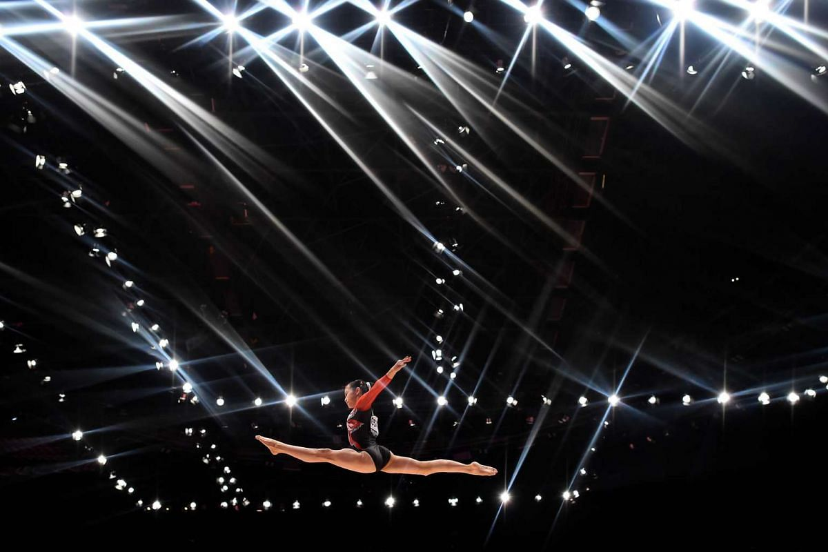 Japan's Aiko Sugihara competing on the beam during the first day of qualification at the 2015 World Gymnastics Championship in Glasgow, Scotland on Oct 23, 2015.