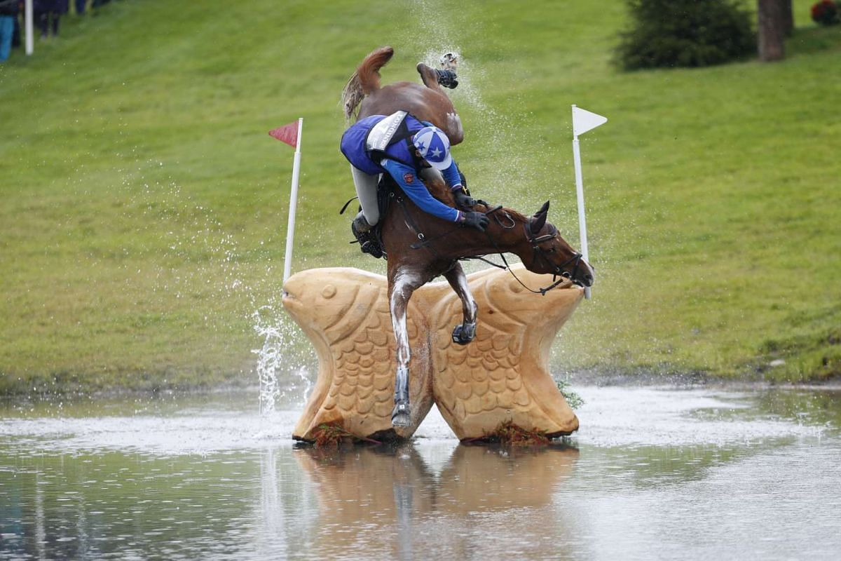 Russia's Mikhail Nastenko, riding Reistag, falling at the Lochan fence in the cross country event of FEI European Eventing Championship at Blair Castle, Scotland on Sept 12, 2015.